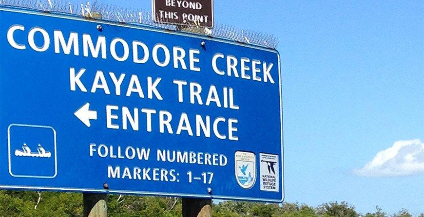 Image of the Commodore Creek Kayak Trail entrance sign at Tarpon Bay Explorers